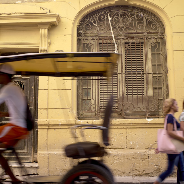 """""""Bicycle taxis ferry peoople around the streets of Havana, Cuba"""" stock image"""