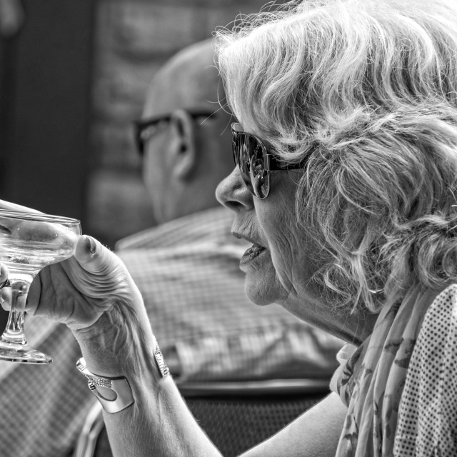 """an older woman with the drink"" stock image"