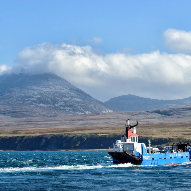 """Ferry crossing to Jura with the paps of Jura in the background"" stock image"
