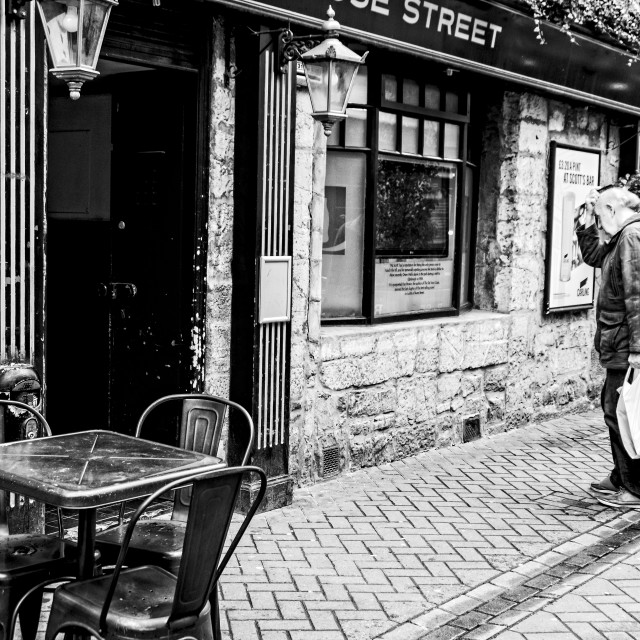 """An old man in front of the pub"" stock image"