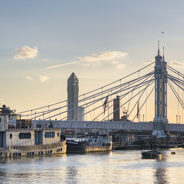 """Chelsea Bridge with moored boats at sunset."" stock image"