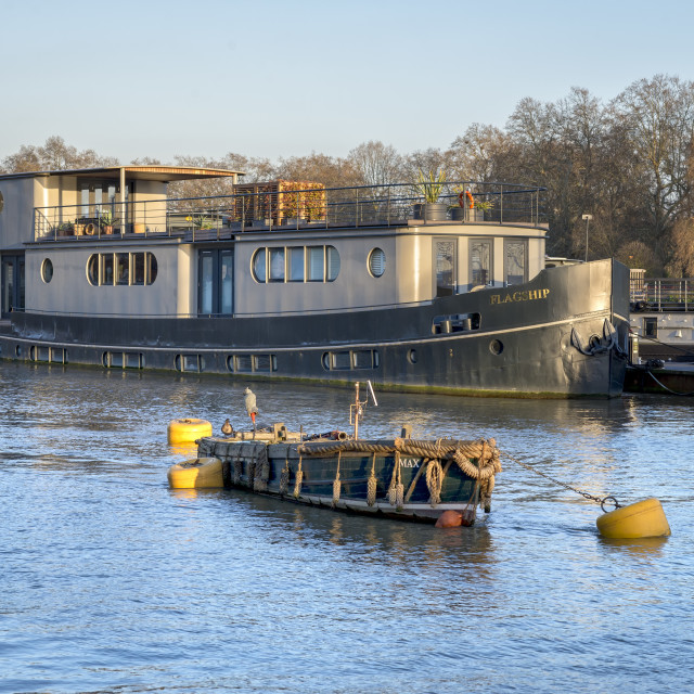 """Boat moored on River Thames, London."" stock image"