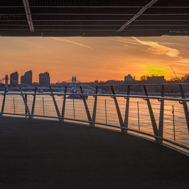 """Sunset at Chelsea & Battersea from under the Chelsea Bridge."" stock image"