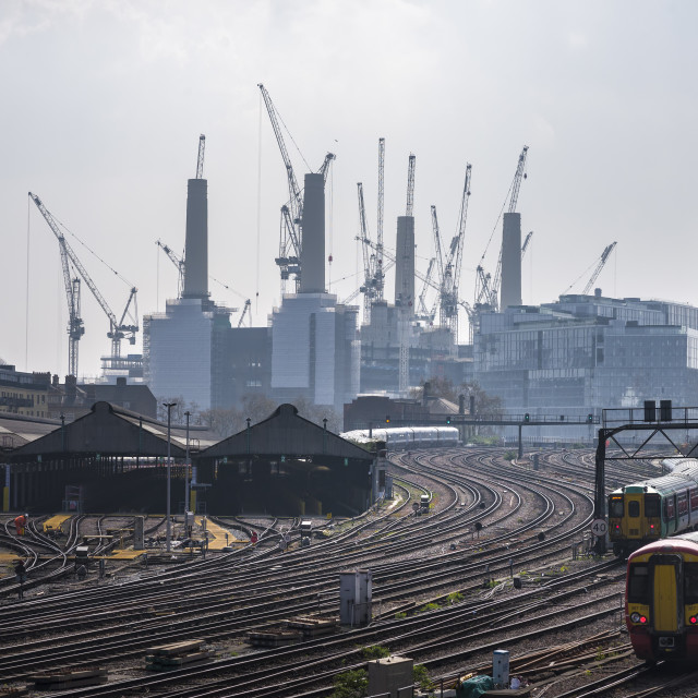 """Battersea Power Station with railways tracks and trains."" stock image"