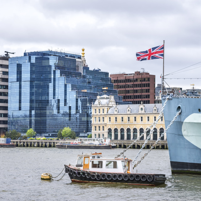 """River Thames, HMS Belfast and Union Jack."" stock image"