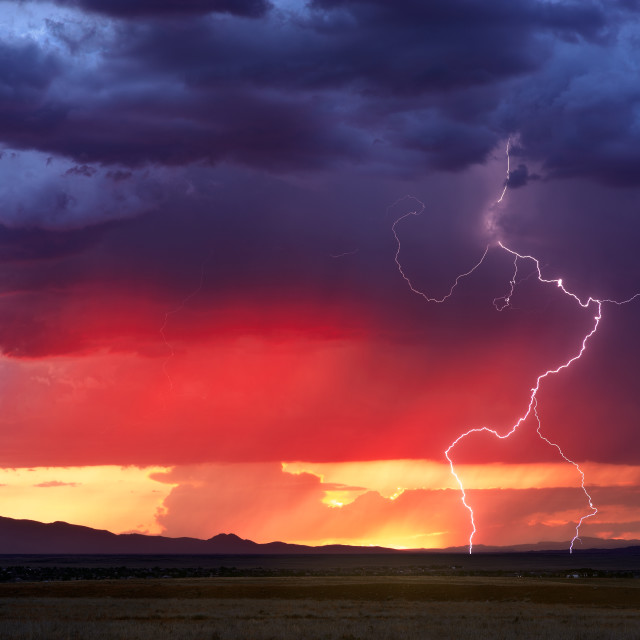 """Dramatic sunset sky with lightning"" stock image"