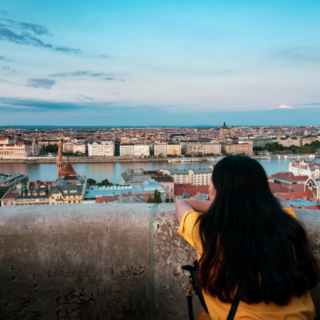 """Woman enjoying Hungarian Parliament view in Budapest buy the Dan"" stock image"
