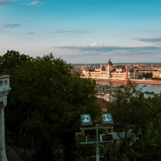 """Hungarian Parliament in Budapest buy the Danube river at sunset"" stock image"