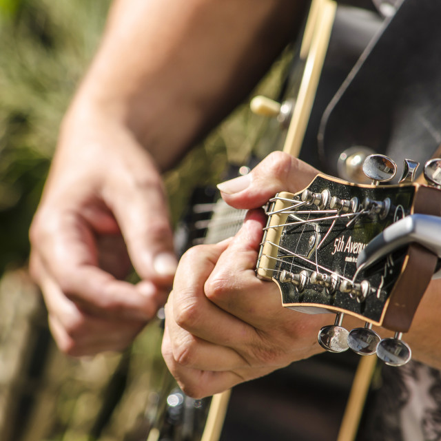 """""""Playing guitar on a sunny day"""" stock image"""