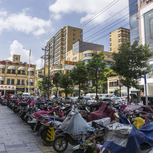 """""""Electric scooters parked up in Kunming city centre, Yunnan province, Southwest China."""" stock image"""