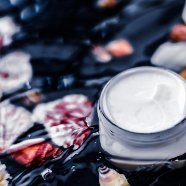 """Sensitive skincare moisturizer beauty face cream on water and sea shells..."" stock image"