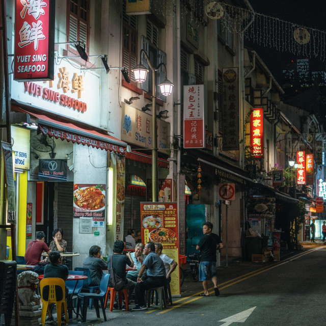 """Chinese people have dinner in street cafe at night in Chinatown"" stock image"