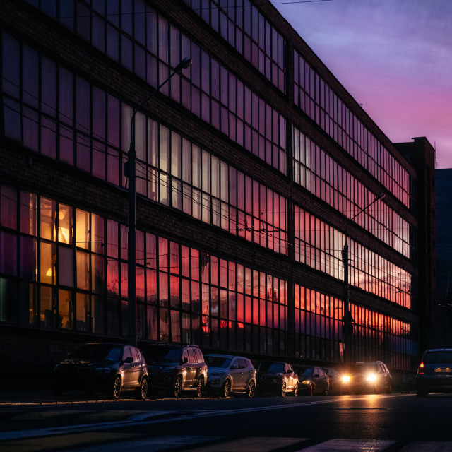 """Sunset reflection in modern glass building windows"" stock image"