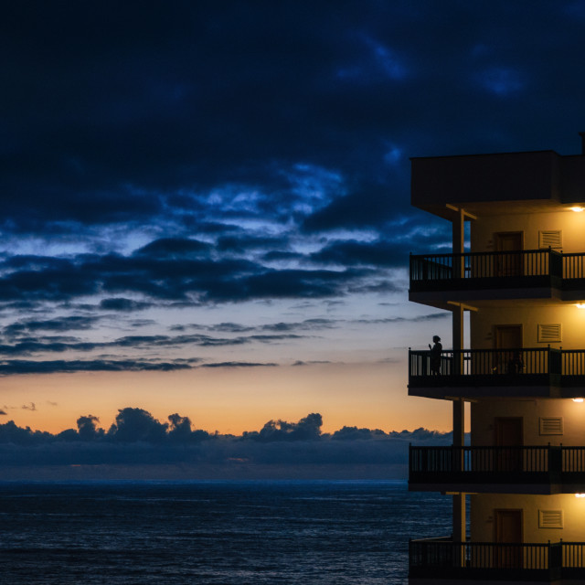 """The tall building against the cloudscape and the sea"" stock image"
