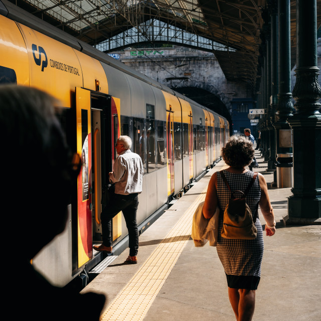 """People enter into a train, Portugal"" stock image"