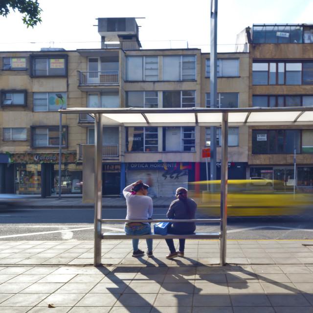 """The Bus Shelter Meeting, Bogota"" stock image"