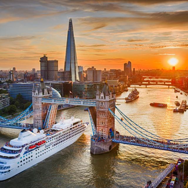 """A cruise ship enters London through Tower Bridge at Sunset"" stock image"