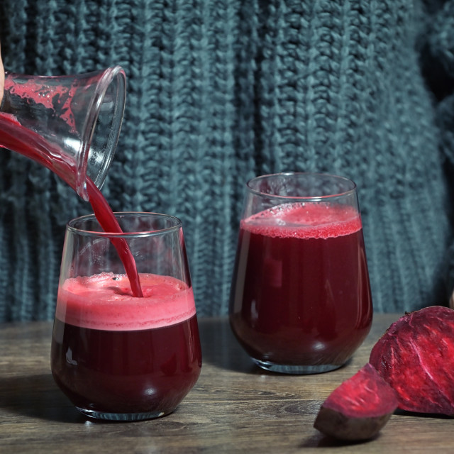 """""""Woman Pouring Self Made Beet Juice"""" stock image"""