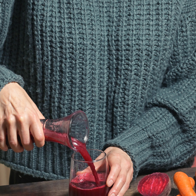 """Woman Pouring Self Made Beet Juice"" stock image"