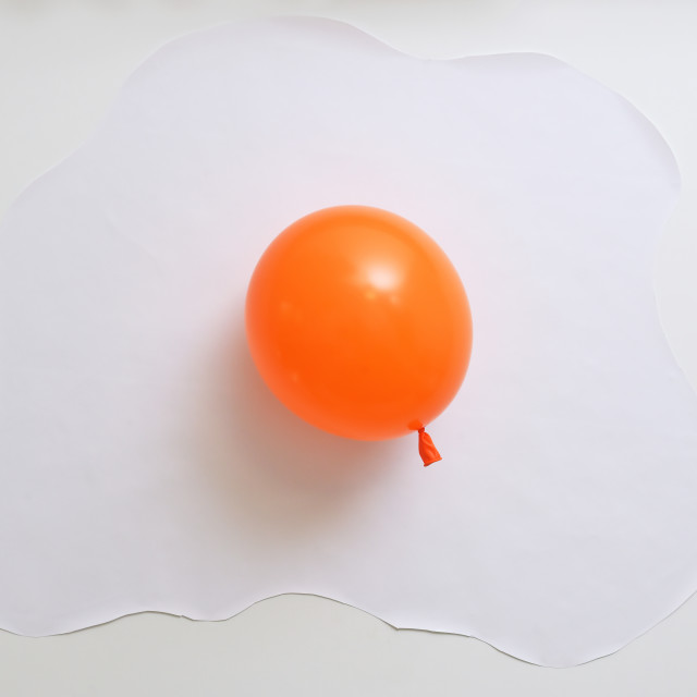 """""""Abstract Orange Balloon In Shape Of An Fried Egg"""" stock image"""