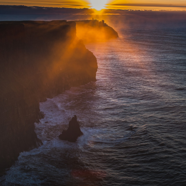 """""""Sun sets on the Cliffs of Moher, Ireland"""" stock image"""