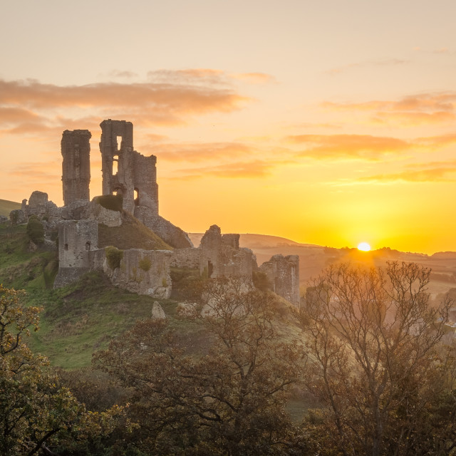 """""""First rays hitting Corfe Castle"""" stock image"""