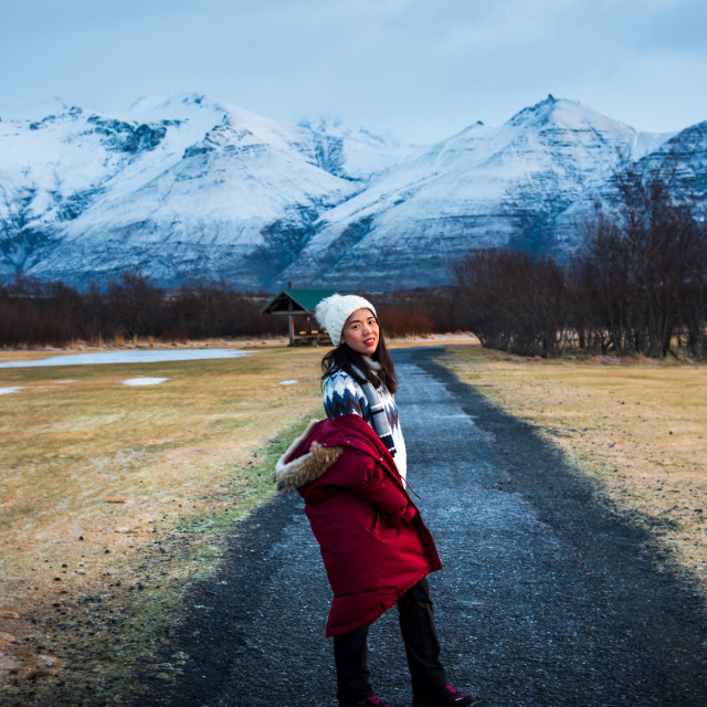 """Female traveler on a scenic road in Iceland"" stock image"