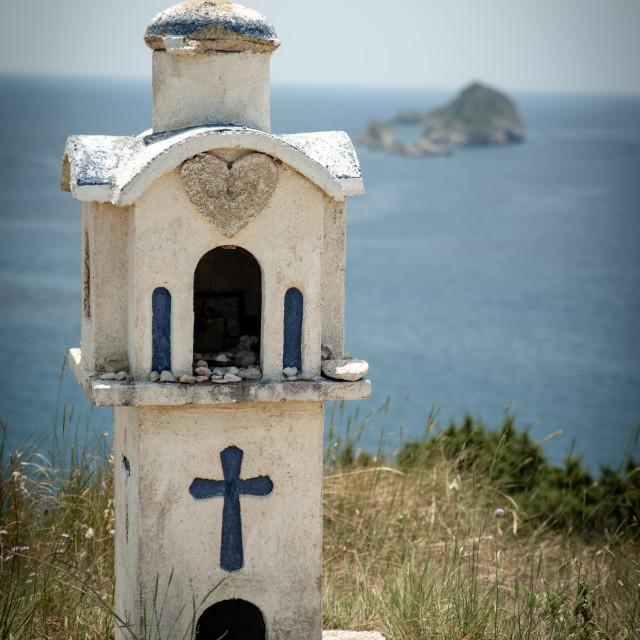 """Beautiful Greek shrine with sea and island"" stock image"