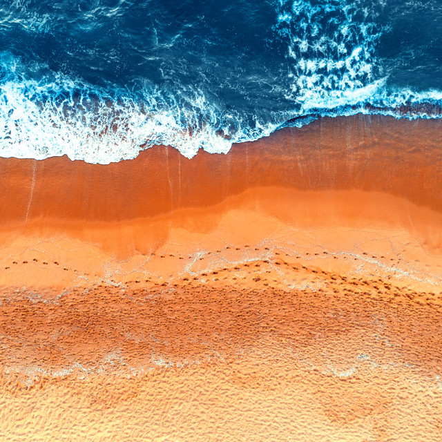 """""""Aerial view of waves in a beach"""" stock image"""