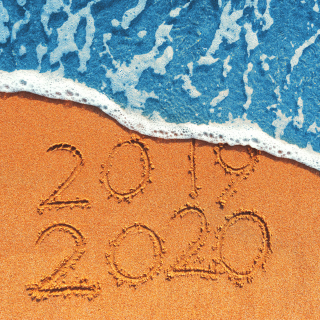 """""""Happy New Year 2020 concept, lettering on the beach. Sea sunrise"""" stock image"""
