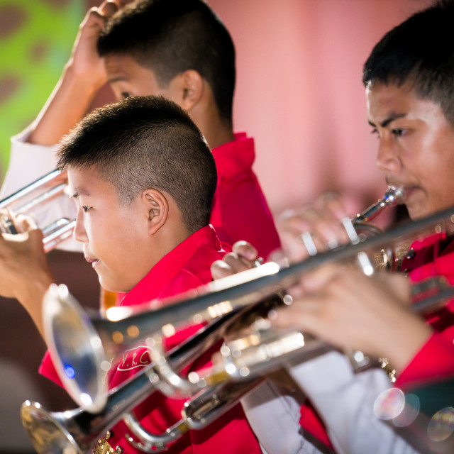 """Thai boys playing brass instruments"" stock image"