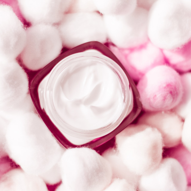 """""""Luxury face cream for sensitive skin and pink cotton balls on background, spa..."""" stock image"""