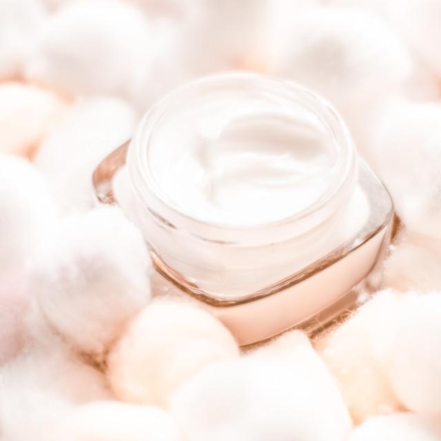 """Luxury face cream for sensitive skin and orange cotton balls on background,..."" stock image"