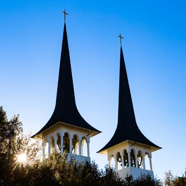 """""""Bells on Hateigskirkja Church Illuminated in Sunlight"""" stock image"""