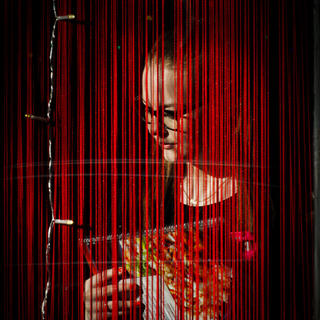 """""""woman behind red curtain"""" stock image"""