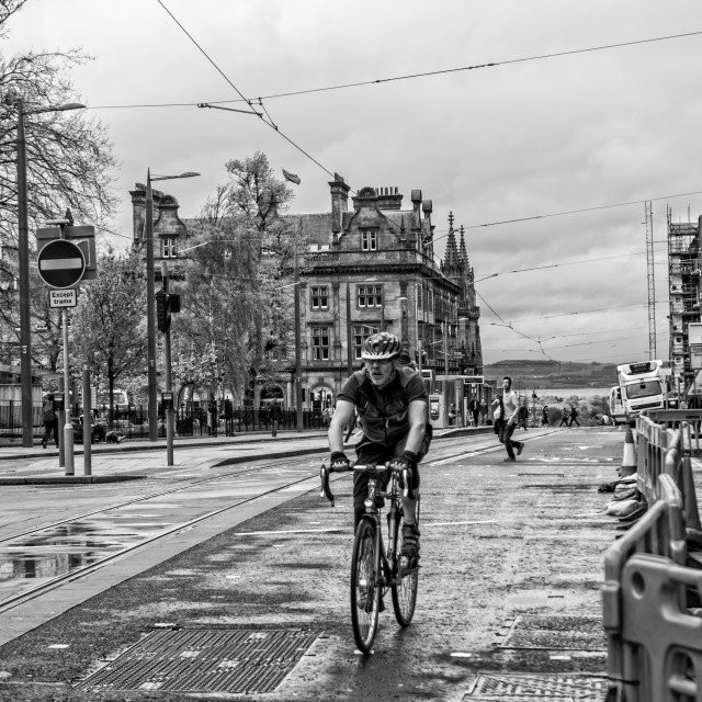 """Cyclist in the rain"" stock image"