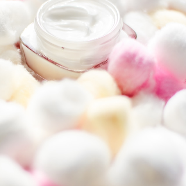 """""""Luxury face cream for sensitive skin and eco cotton balls on background, spa..."""" stock image"""