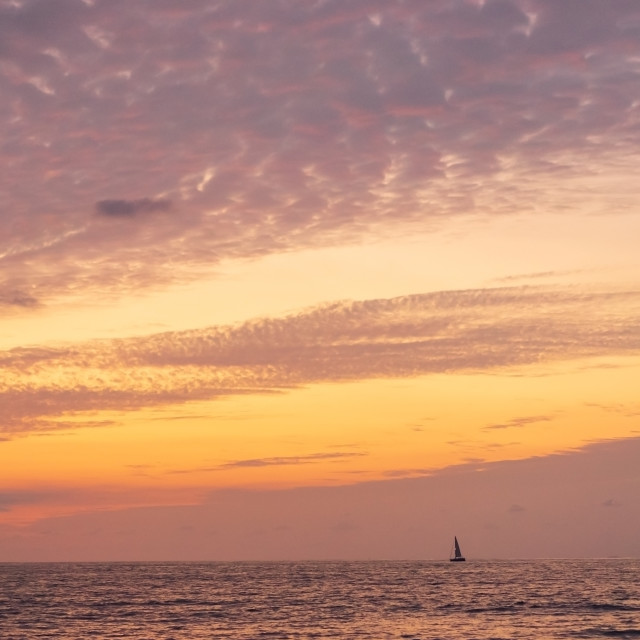 """""""Boat on the horizon at dawn off the Pacific coast of Mexico"""" stock image"""