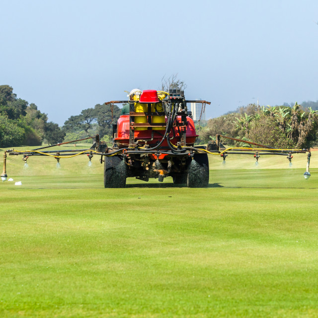 """Golf Course Machine Spraying Putting Green Treatment"" stock image"
