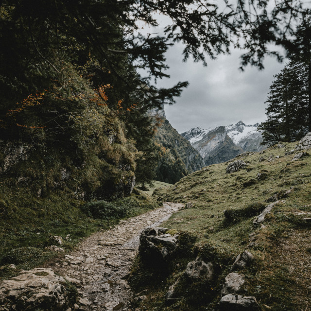 """Stony trail in the Switzerland mountains to the lake Seealpsee during the cloudy autumn afternoon"" stock image"