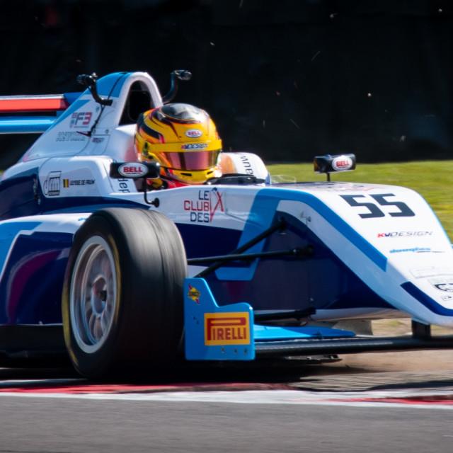 """""""Racing car kicking up the gravel"""" stock image"""