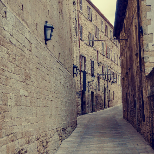 """View into ancient street of Urbino town"" stock image"