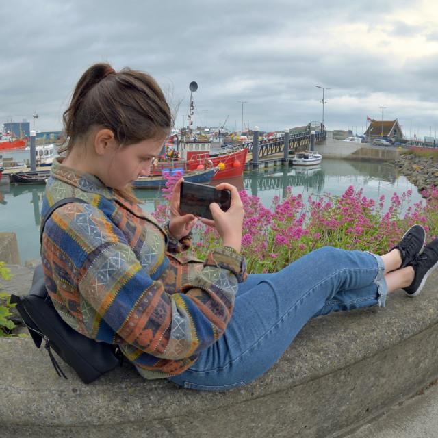 """Teen Girl Using Smartphone On Vacation"" stock image"