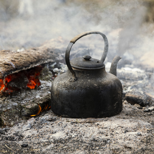 """Boiling kettle on a campfire"" stock image"