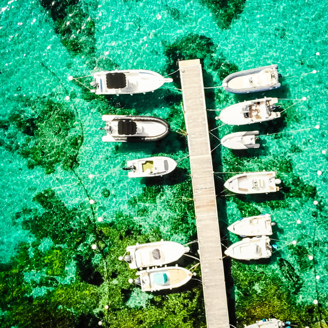 """Boats moored on a jetty"" stock image"