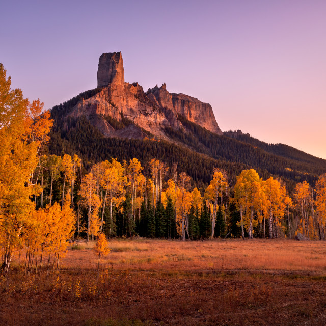 """Fall colors at Chimney Rock in Owl Creek Pass"" stock image"