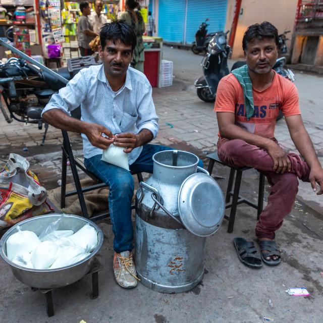 """Indian men selling fresh milk in the street, Rajasthan, Jodhpur, India"" stock image"
