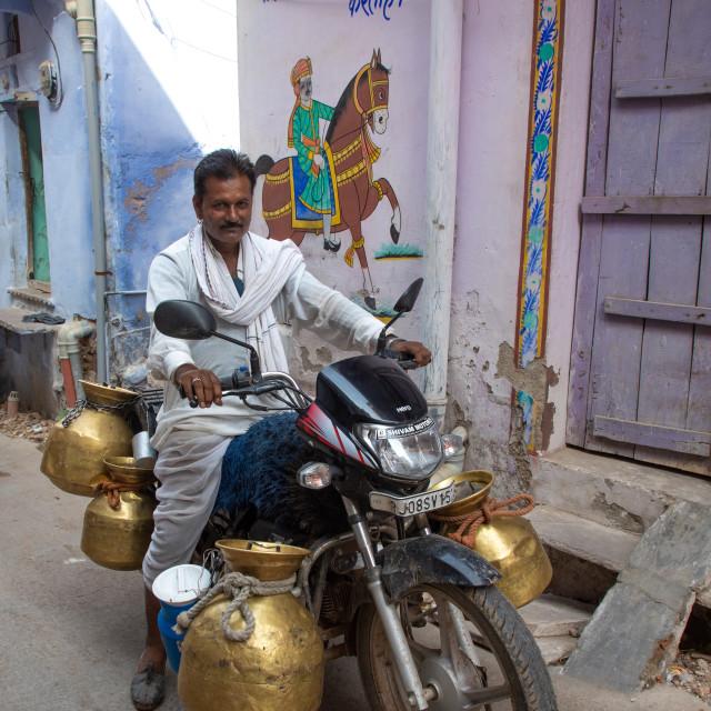 """""""Indian man delivering fresh milk with his motorbike, Rajasthan, Bundi, India"""" stock image"""