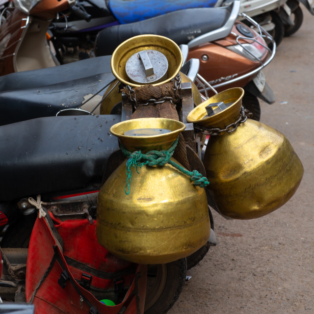 """Milk jugs on a motorbike, Rajasthan, Bundi, India"" stock image"