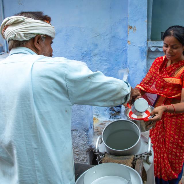 """""""Indian man delivering fresh milk door to door with his motorbike, Rajasthan,..."""" stock image"""